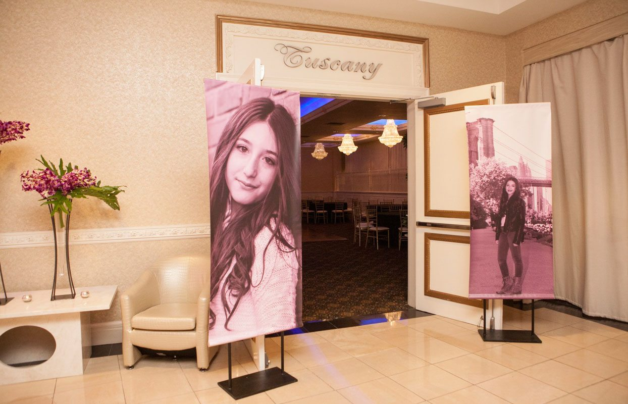 Entrance to ballroom with large photos of girl Lathrop__5th_avenue_digital_016320141213JDAARachelOshinBM
