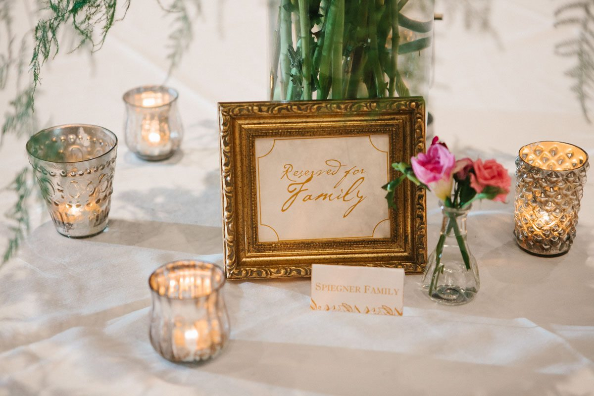 Gold Framed Reserved for Family Setting with Candles