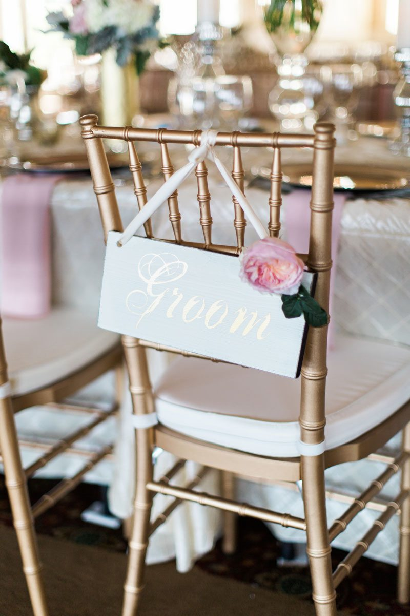 Groom gold chair closeup with sign christyandtaylor-w-0514