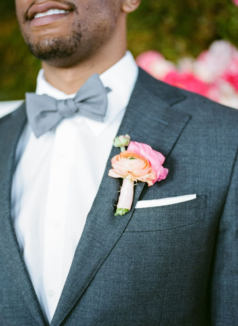 _Groom in gray tux with orange boutonniere lemigamichelle_ellegolden-26