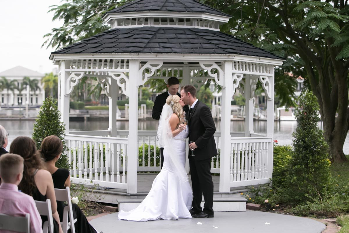 Kiss the bride holding champaign Wilcox_Soplinski_Carrie_Wildes_Photography_CWP0616