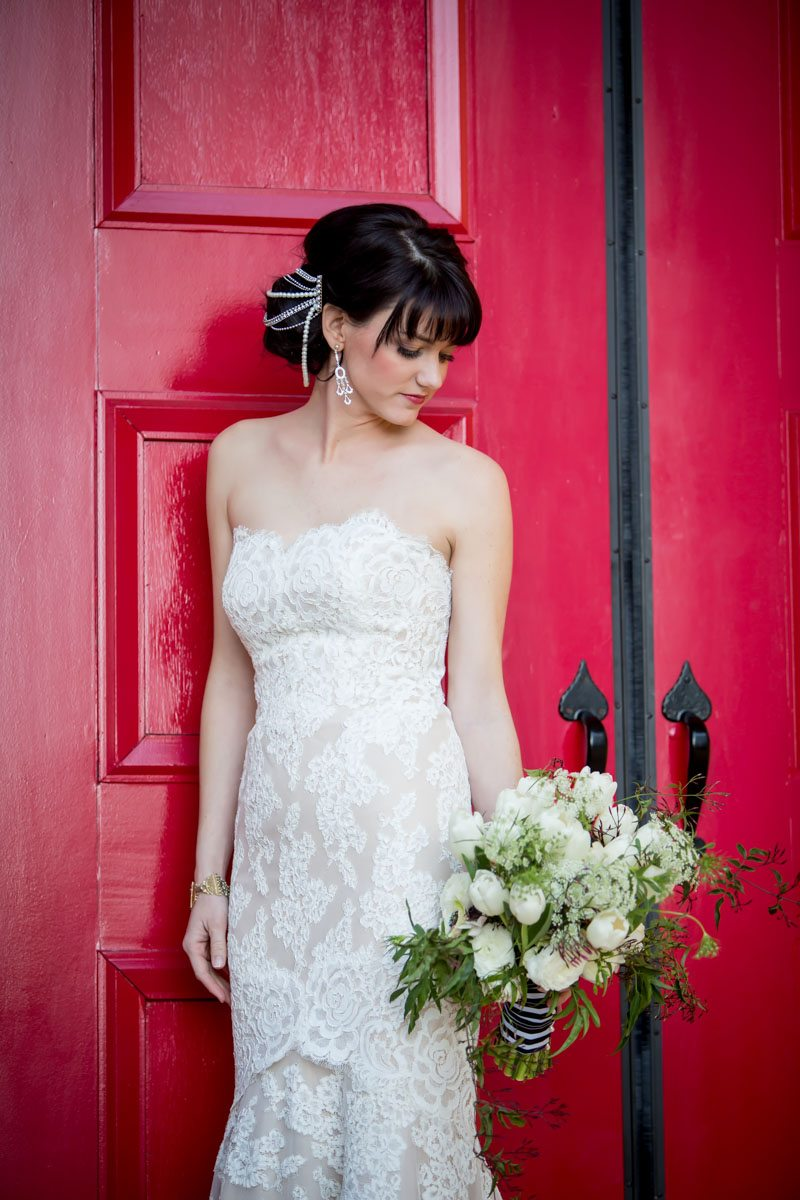 Lace gown and hair piece feature with red door and bouquet Townsend_Coffee_Janet_Howard_Studio_Coffee0214