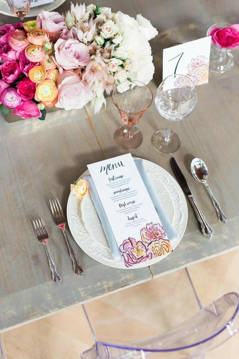 _Menu on table with florals in the top of photo lemigamichelle_ellegolden-59