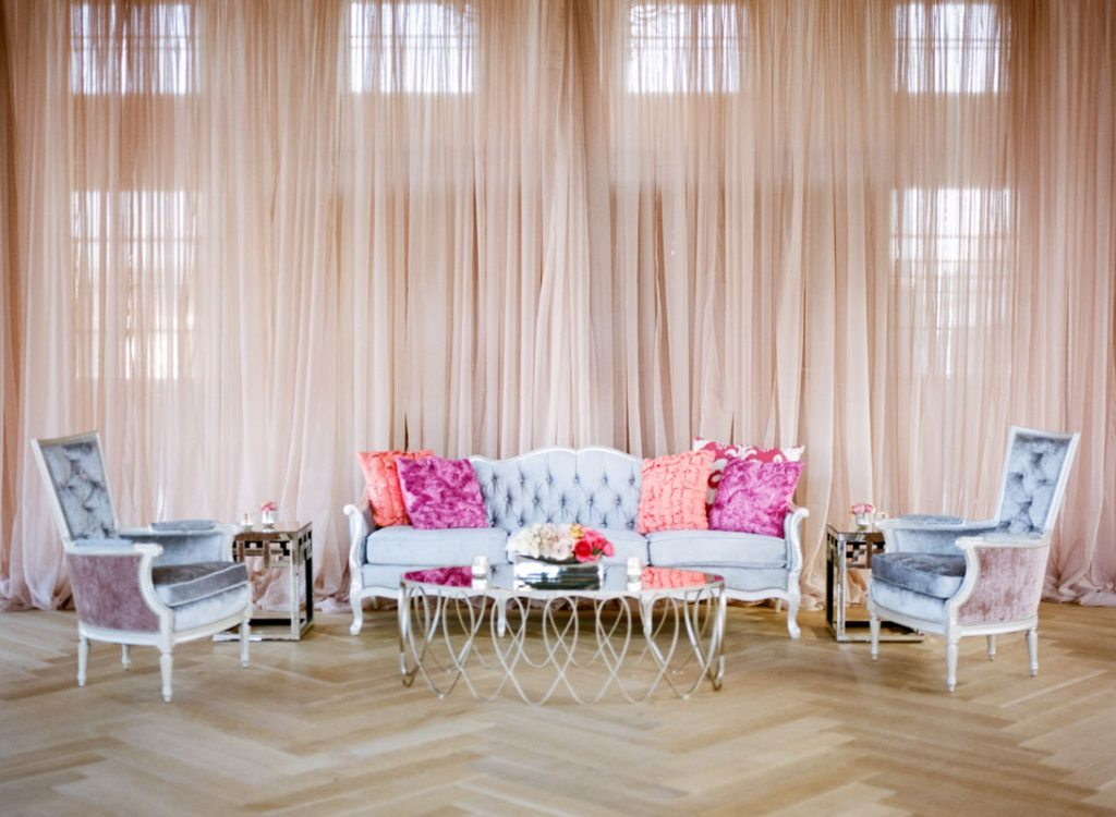 _Plush gray couch lounge area with pink draping lemigamichelle_ellegolden-218