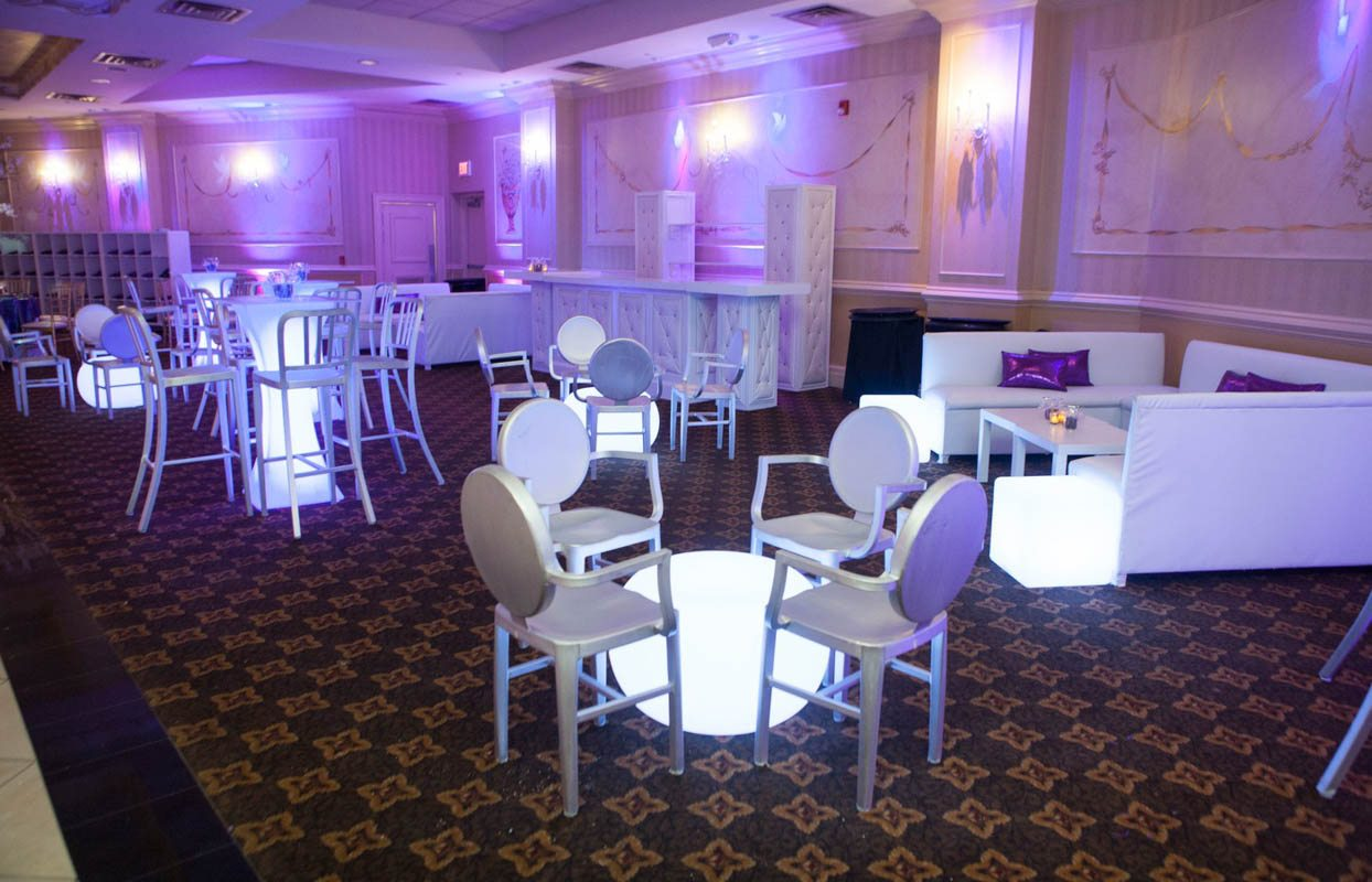_Purple uplighting white furniture lounge area Lathrop__5th_avenue_digital_025120141213JDAARachelOshinBM