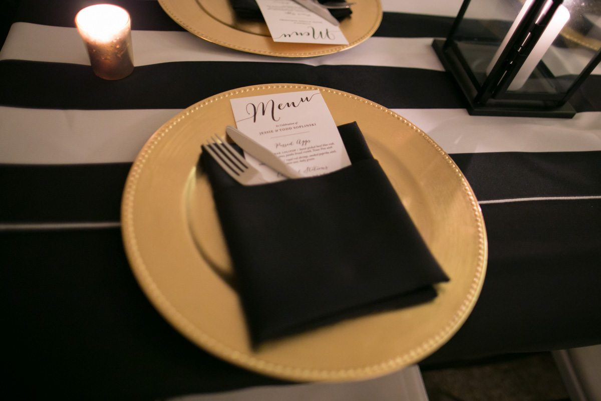 Reception table close up with yellow plates black linens reception table set up Wilcox_Soplinski_Carrie_Wildes_Photography_CWP0393