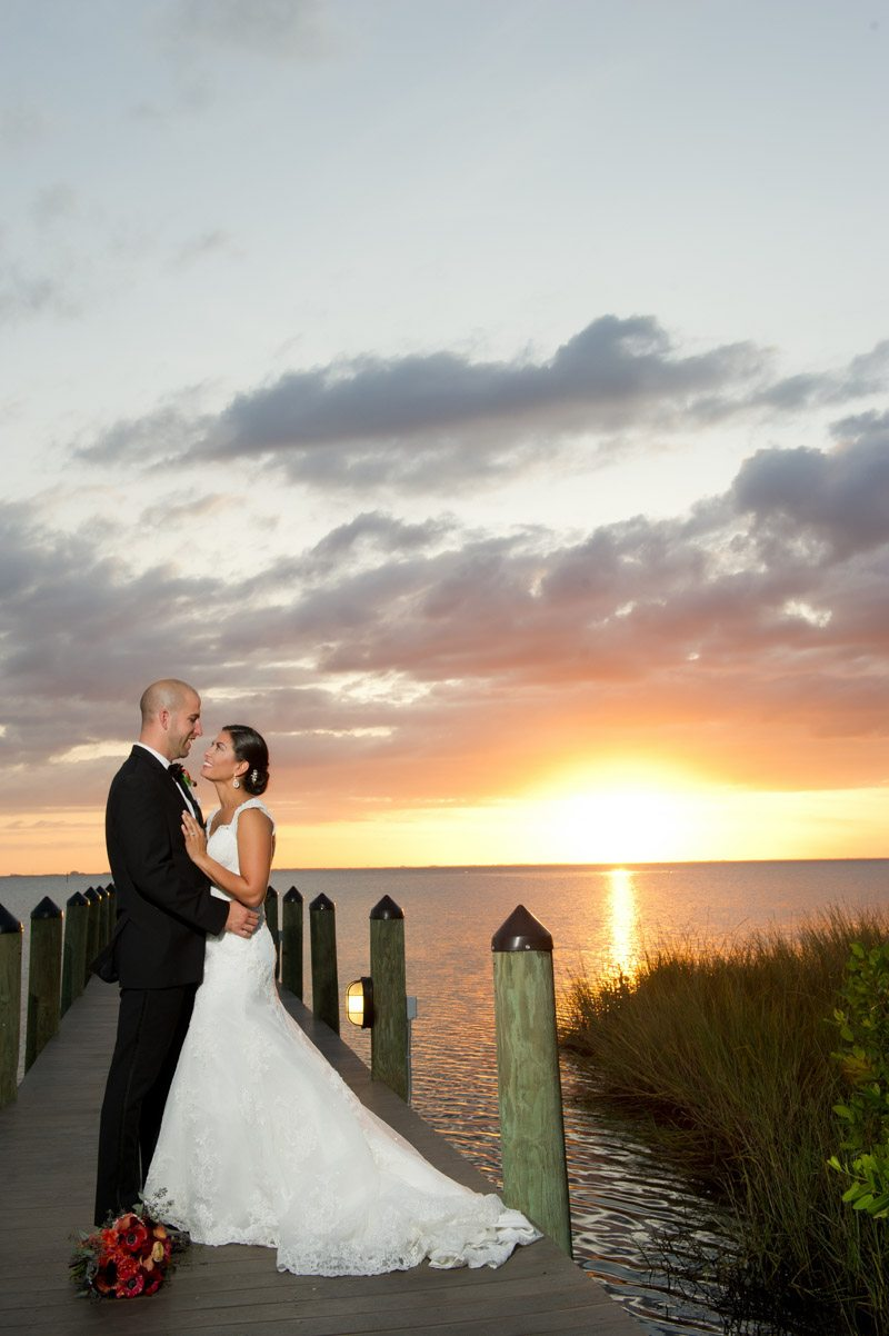 Sunset Over Water Bride and Groom