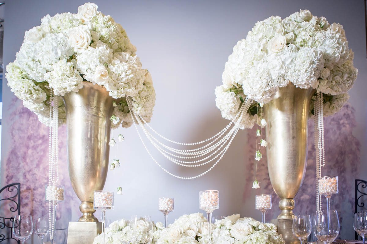 _Tall hydrangea centerpieces in rose gold holders with pearls strung between ScoobieBlushShoot-098