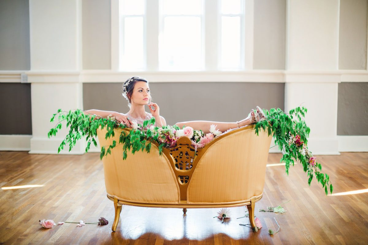 Tan Orange Chair Green Foliage with Bridesmaid