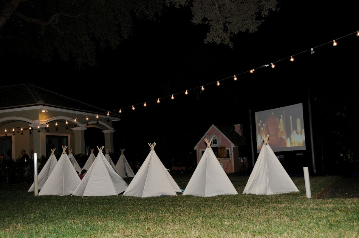 Teepees and Lights with Movie Playing Night