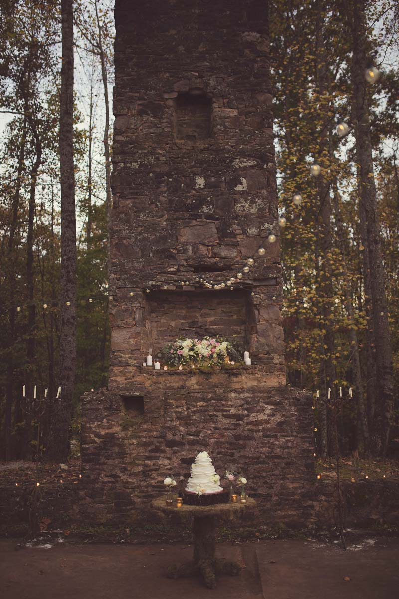 Vintage brown brick column with lights and white cake