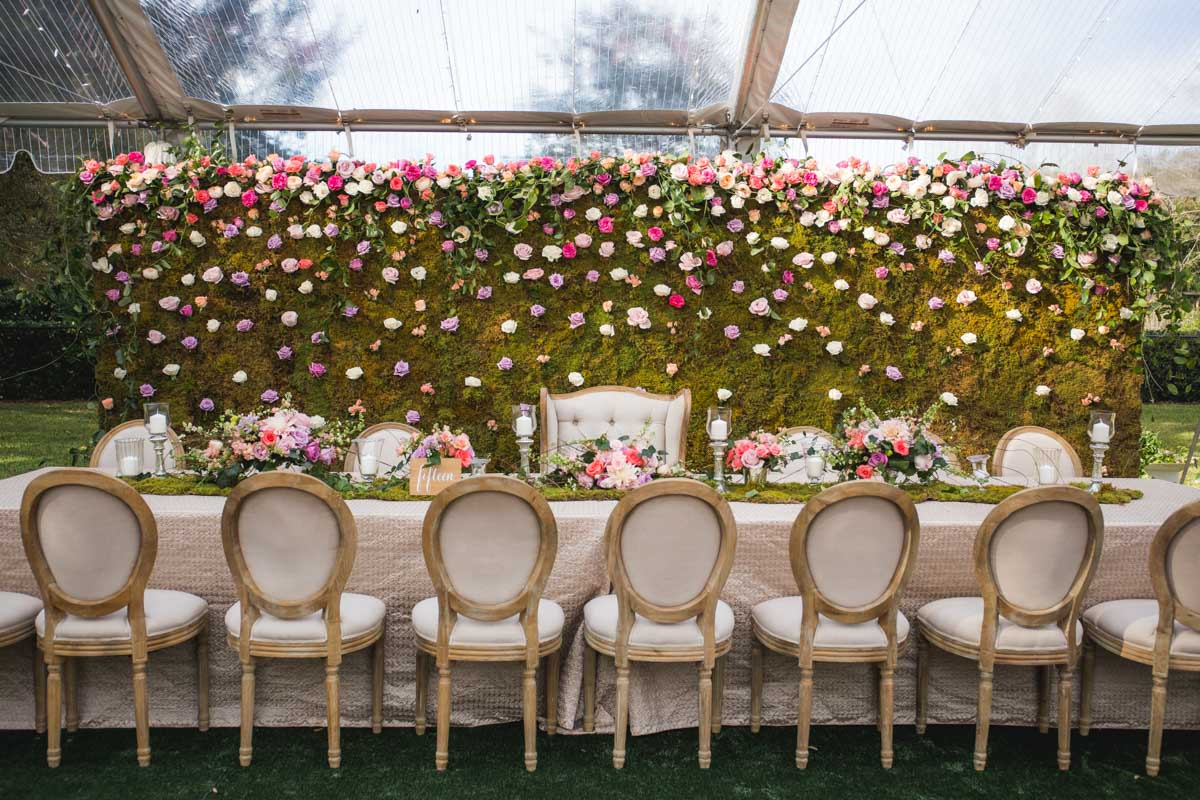 White Table in Front of Green Floral Wall