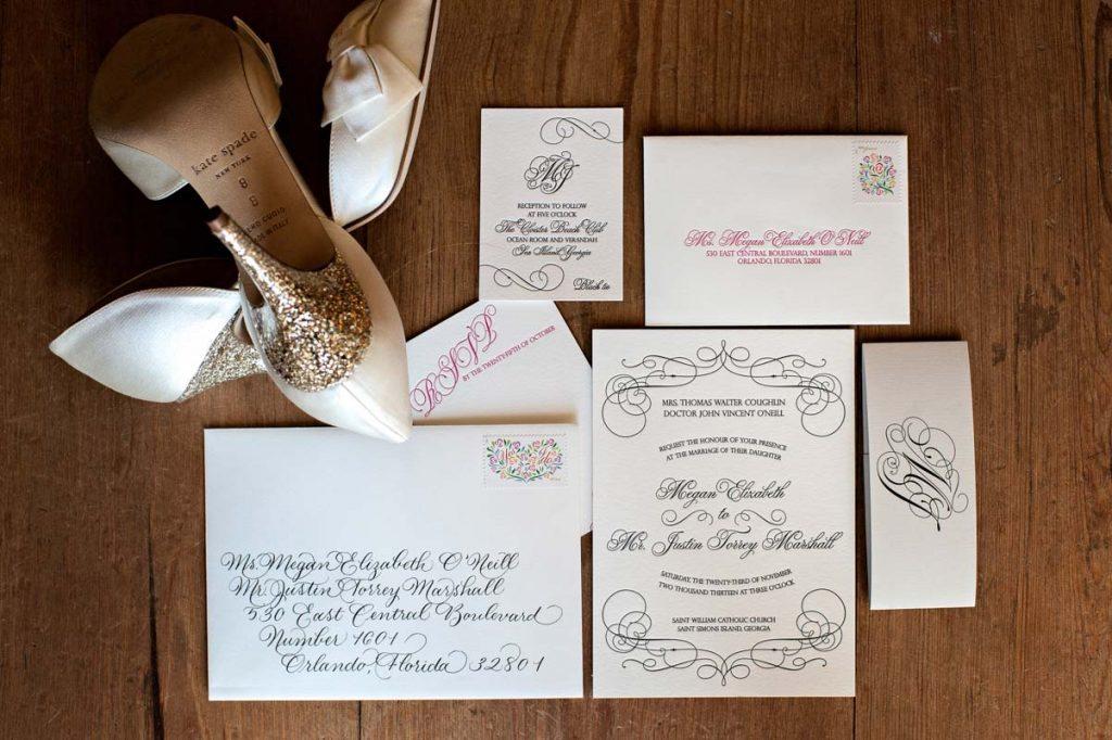 White invites black and pink cursive script glittery kate spade heel