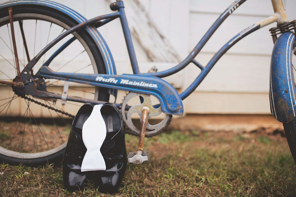 black polished mens dress shoes with blue bike