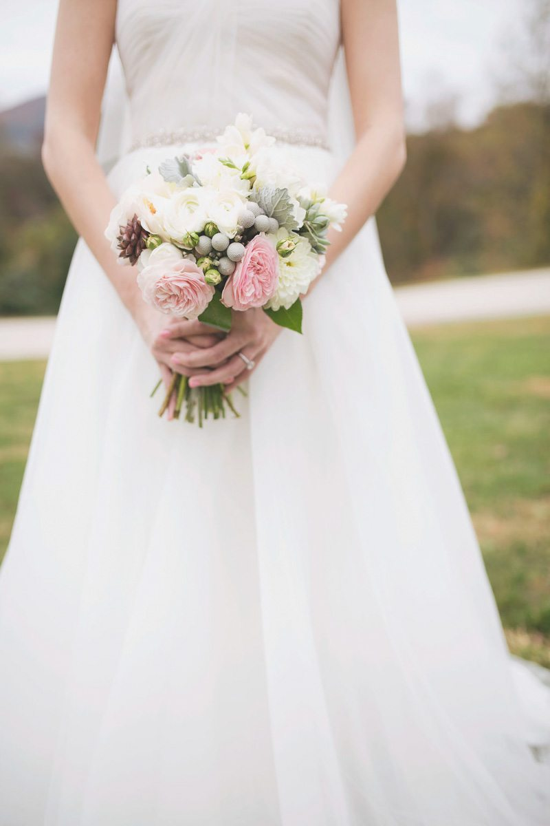bride in gown with white and pink bouquet