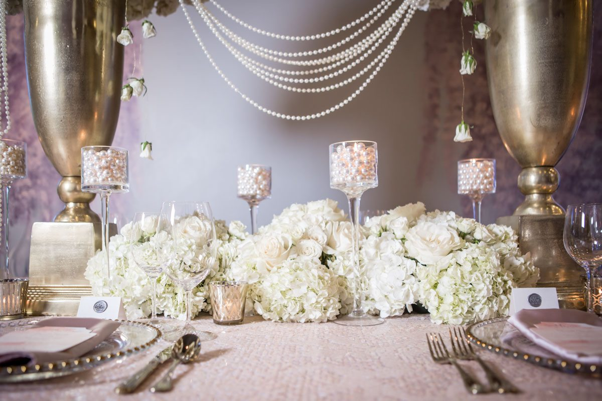 _close up of the hydrangea table runner and pearls in candle holders ScoobieBlushShoot-097