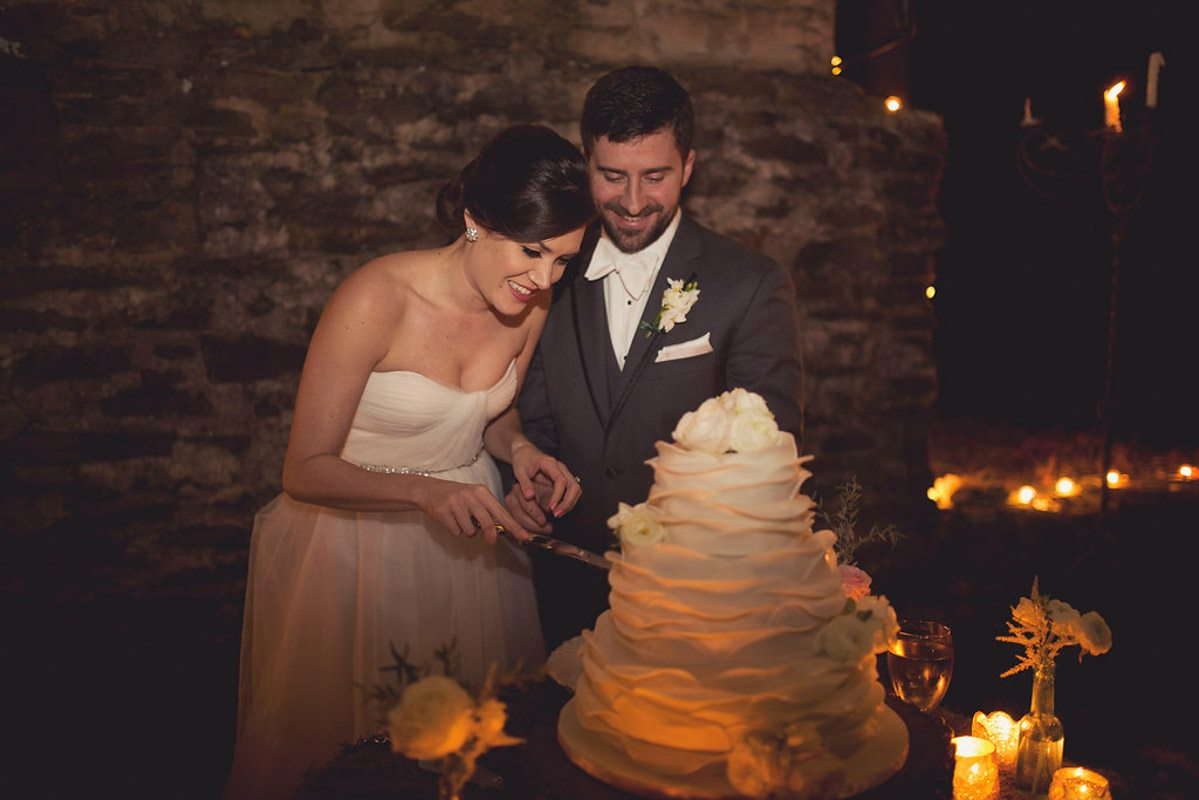 cutting white layered cake