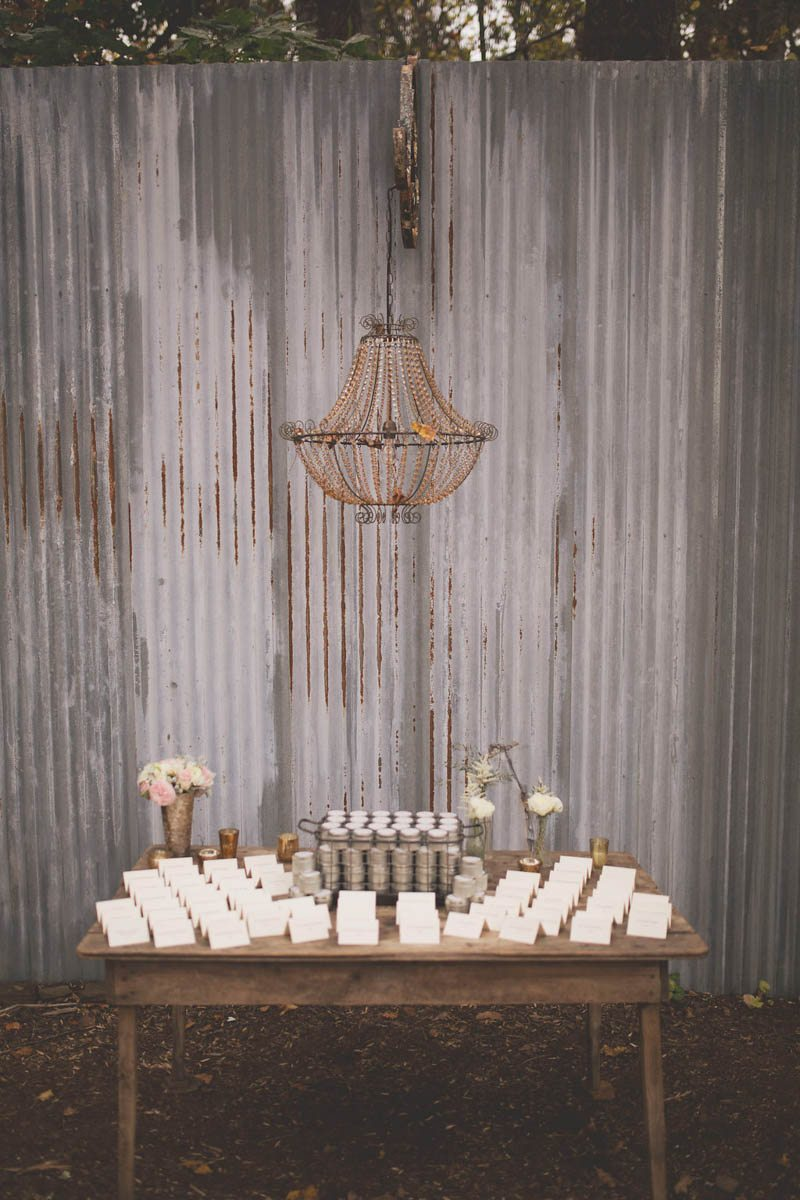 vintage gray panel gold chandelier wooden table with placecards