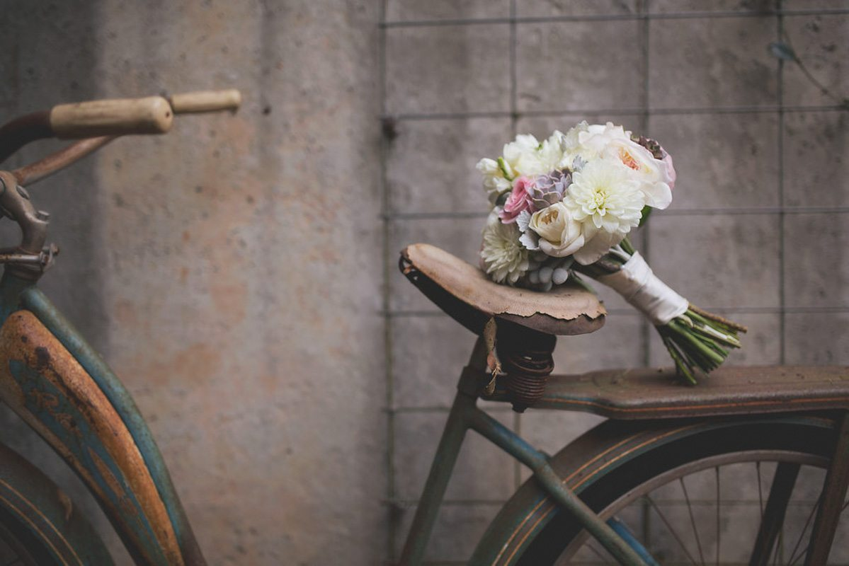white bouquet on rusted bike