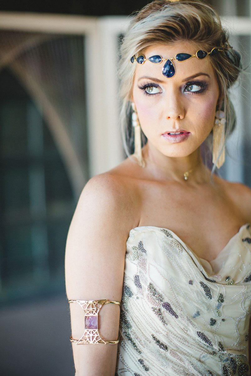 Boho styled bride blue jeweled headband and gold and pink stoned arm bracelet