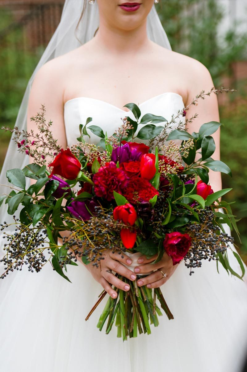 Bouquet with red and purple flowers and berries