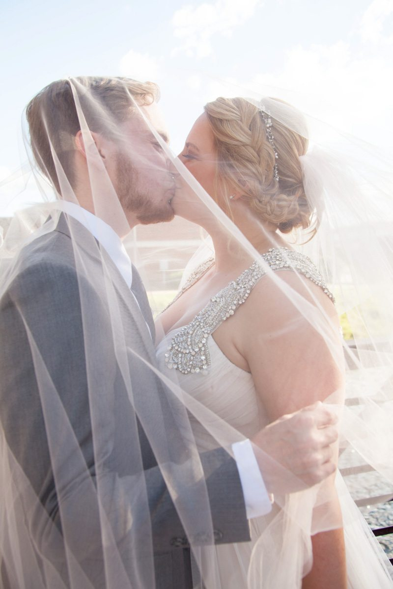 Bride and groom kissing under veil Smith_Neesley_Sarah_Melyssa_Photography_IMG02412