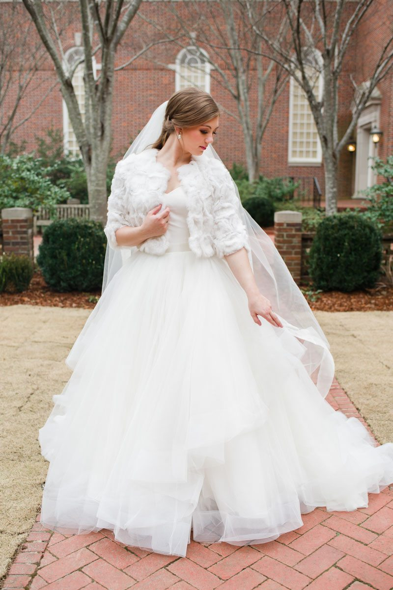 Bride in gown with white fur coat