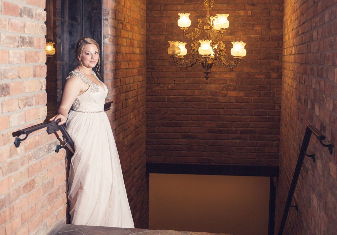 Bride indoors on stairs Smith_Neesley_Sarah_Melyssa_Photography_IMG0406