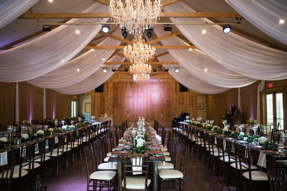 Chandeliers and draping with long farm tables sarahannayphotography-05152016-reception-1