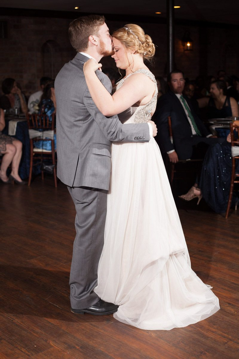 First dance kissing bride's forehead Smith_Neesley_Sarah_Melyssa_Photography_IMG02942
