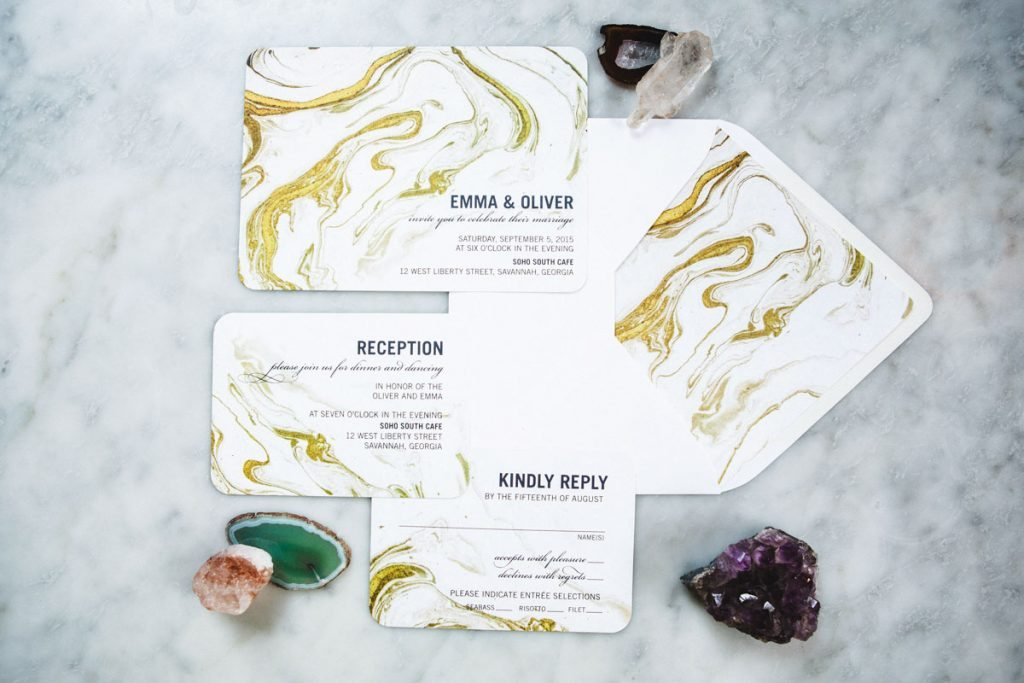 Gold and white marble invitations
