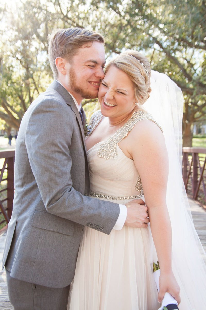 Groom kissing bride's cheek and laughing Smith_Neesley_Sarah_Melyssa_Photography_IMG02362