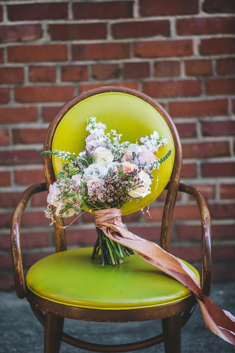 Pink and rose bouquet on bright green chair