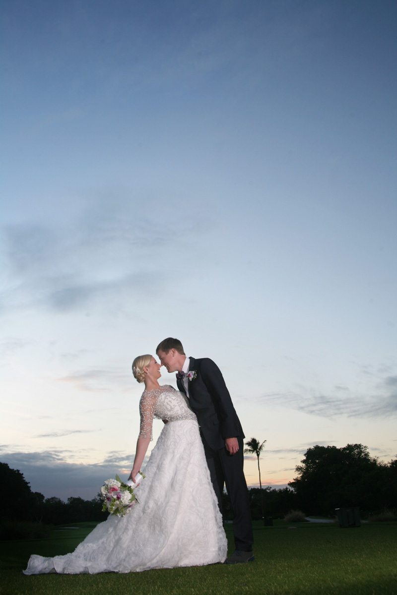 Sunset bride and groom pose