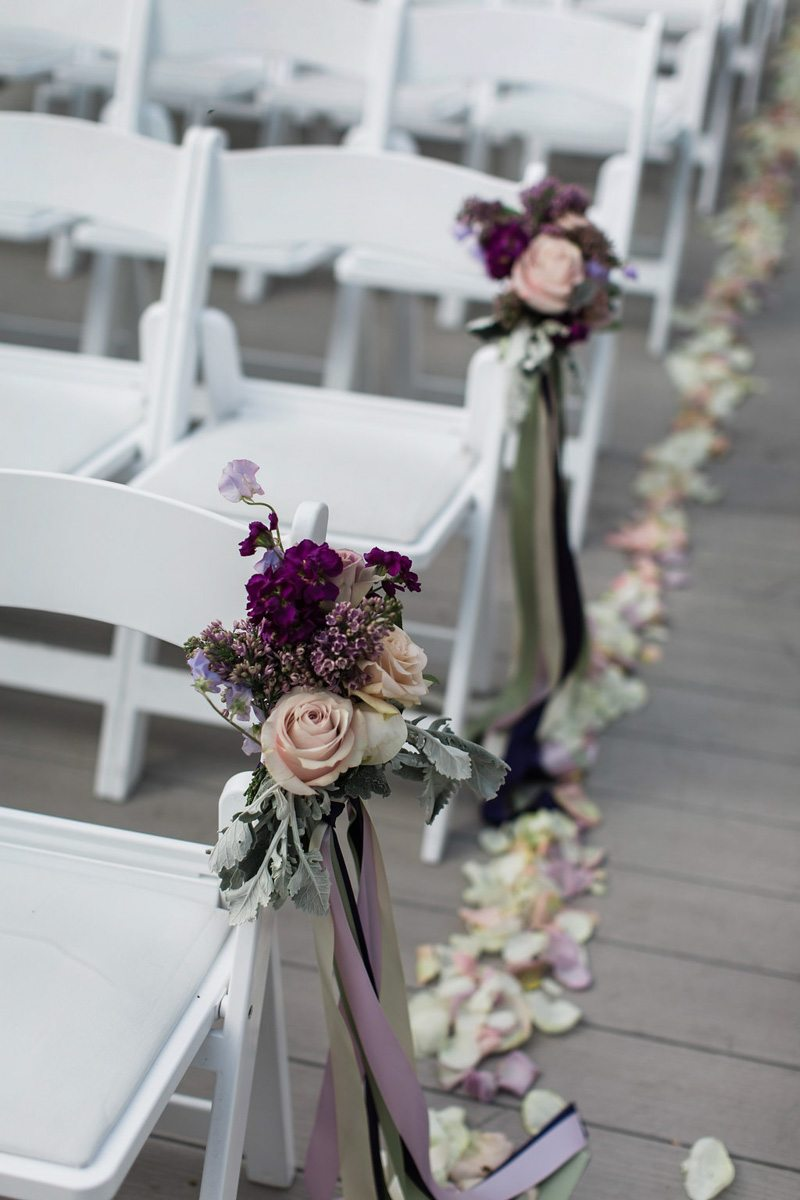 ceremony aisle decor rose petals garden rose posy purple silk ribbon