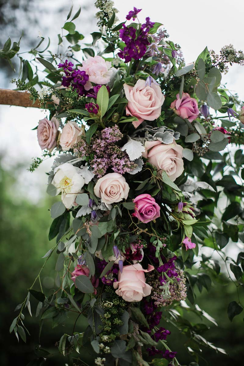 garden rose and wax flower ceremony arch arrangement