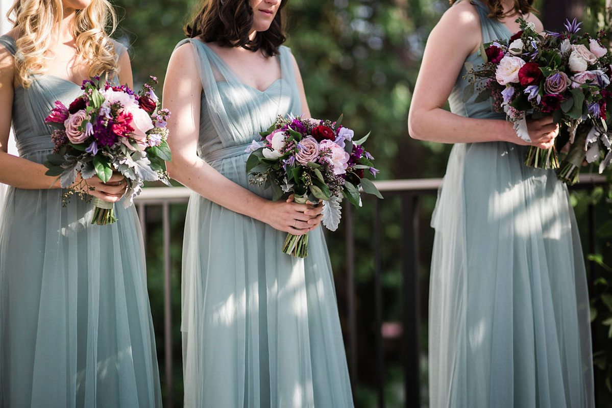 gray blue and purple bridesmaid dress bouquet