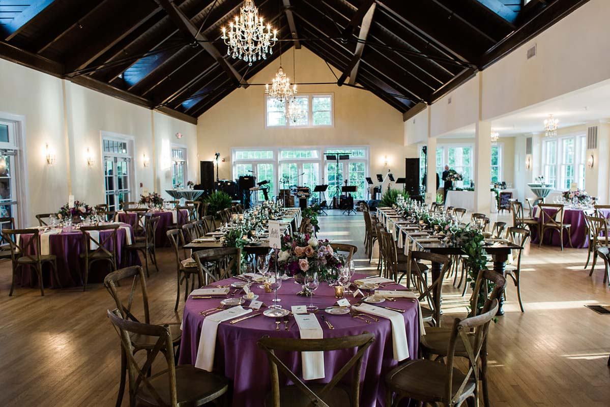 purple indoor wedding reception napa chairs