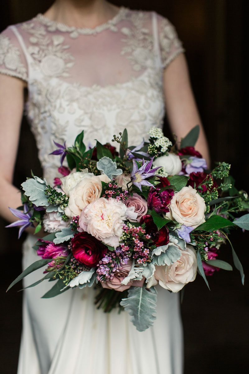 red and purple wedding bouquet garden roses