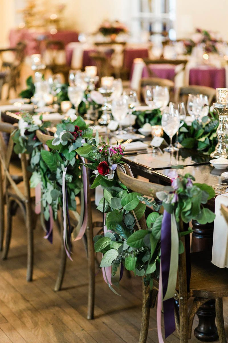 sweetheart seats with garland and ribbon