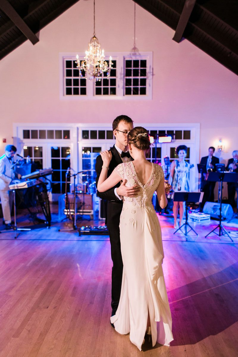 vintage reception with modern uplighting first dance