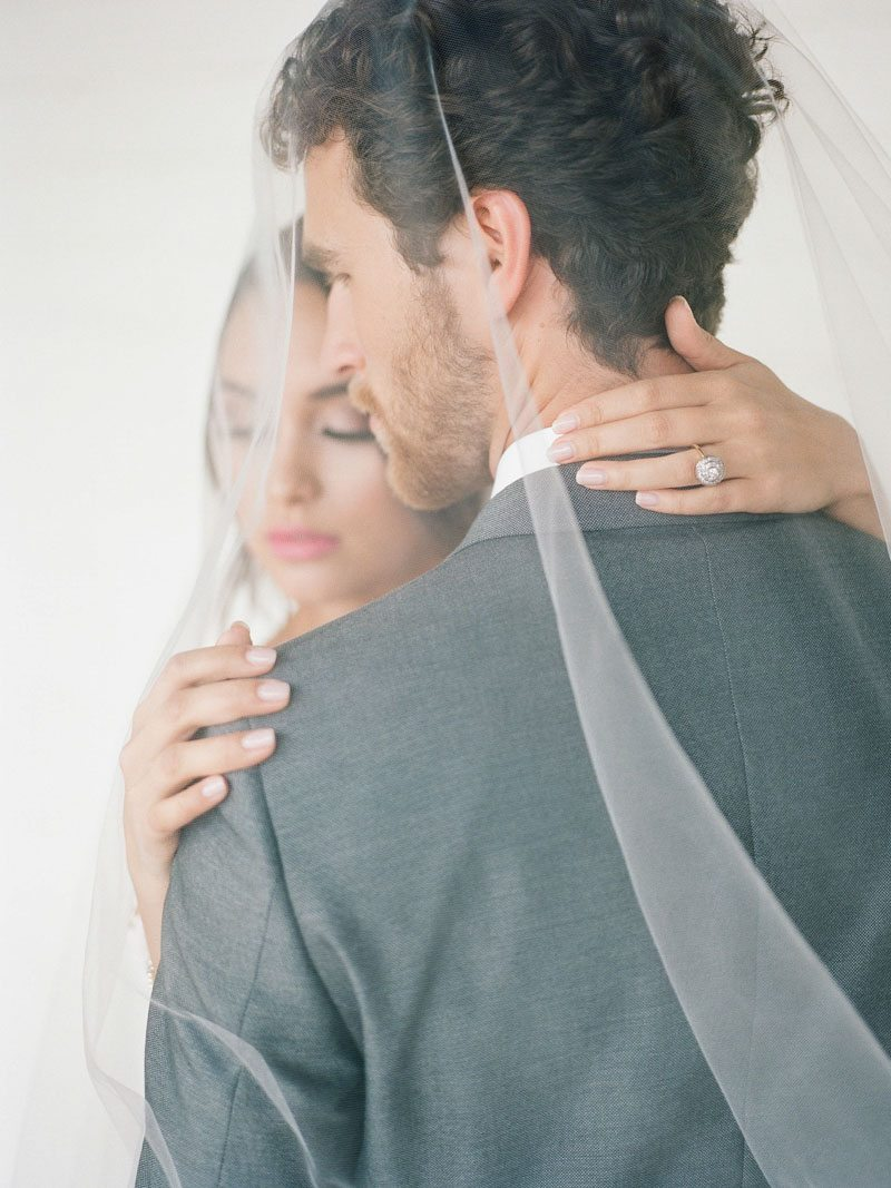 bride-groom-under-veil-the-stave-room-davy-whitener-photography-1