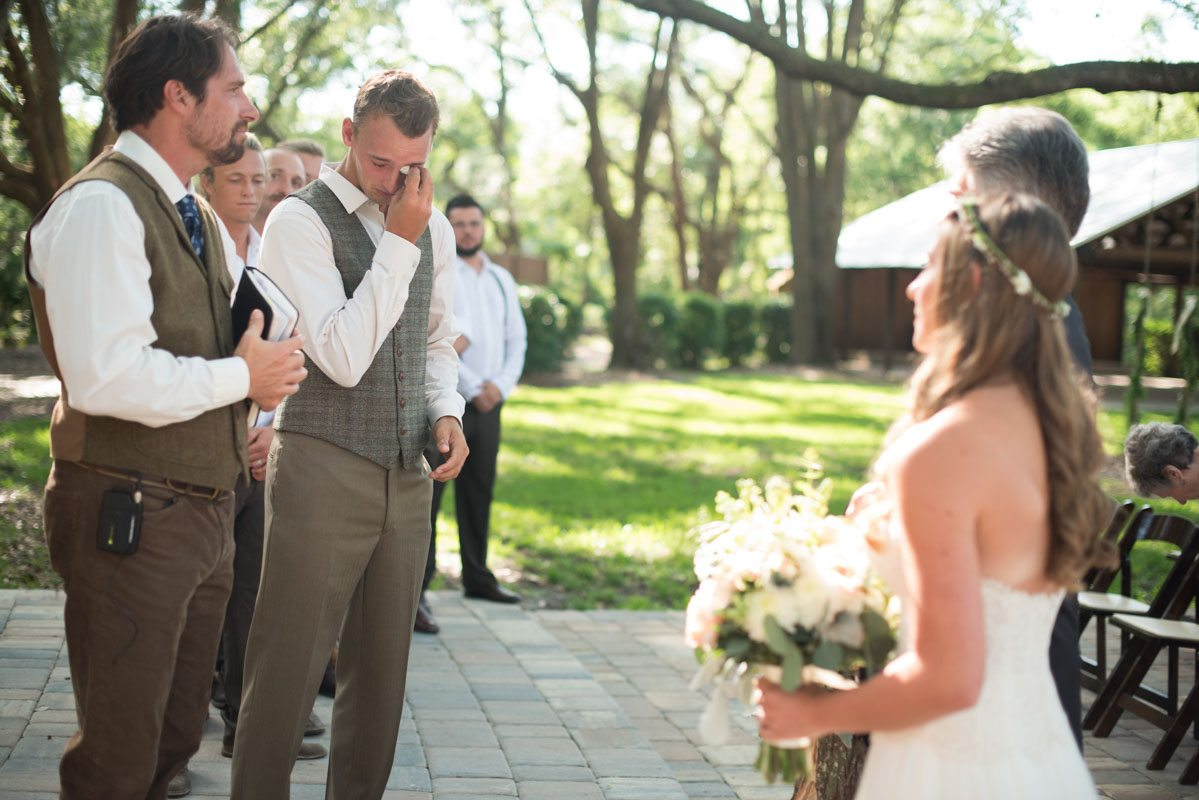 Groom wipping eyes after bride reaches the end of the aisle sarahannayphotography-05152016-ceremony-63