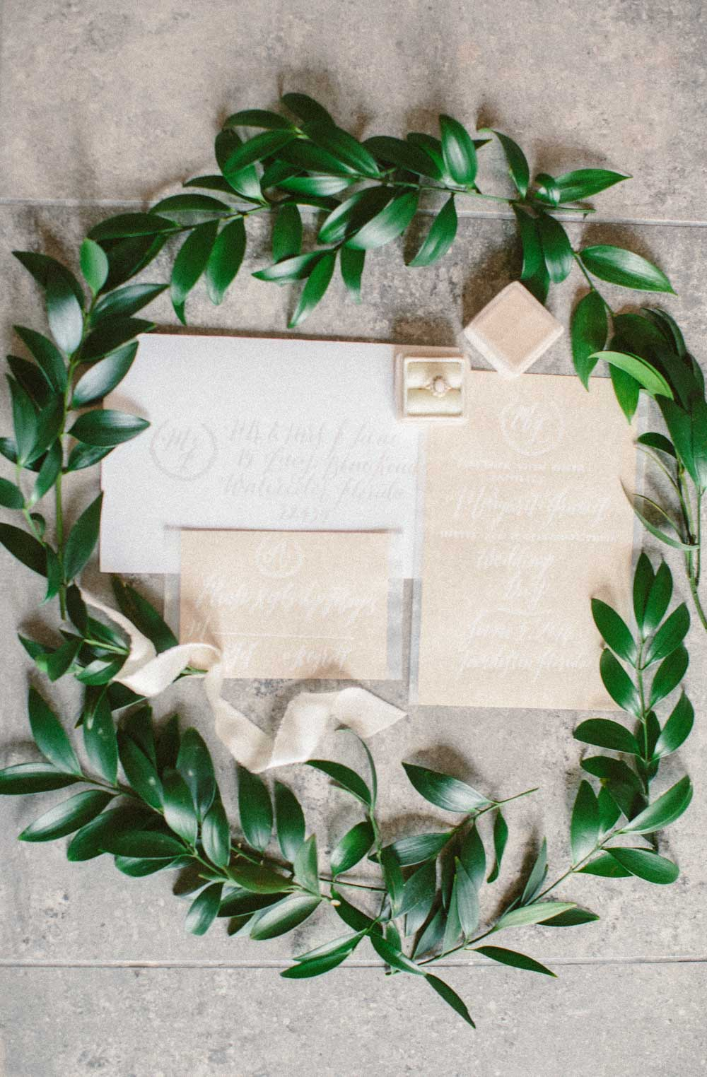 beige and white lettering invitations