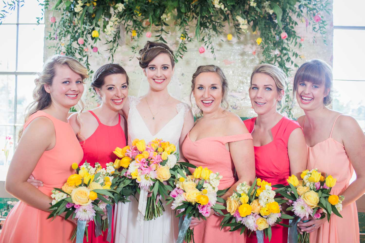 blush-and-pink-and-yellow-bridesmaids-dresses-and-flowers