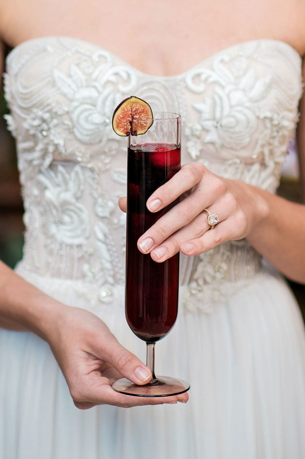 bride-holding-tall-glass-of-sangria-kristen-weaver-photography-bella-collina-56-of-126
