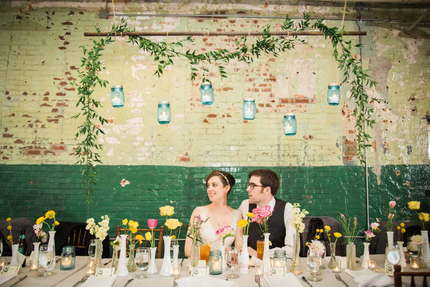 candlelit-brightly-colored-floral-head-table