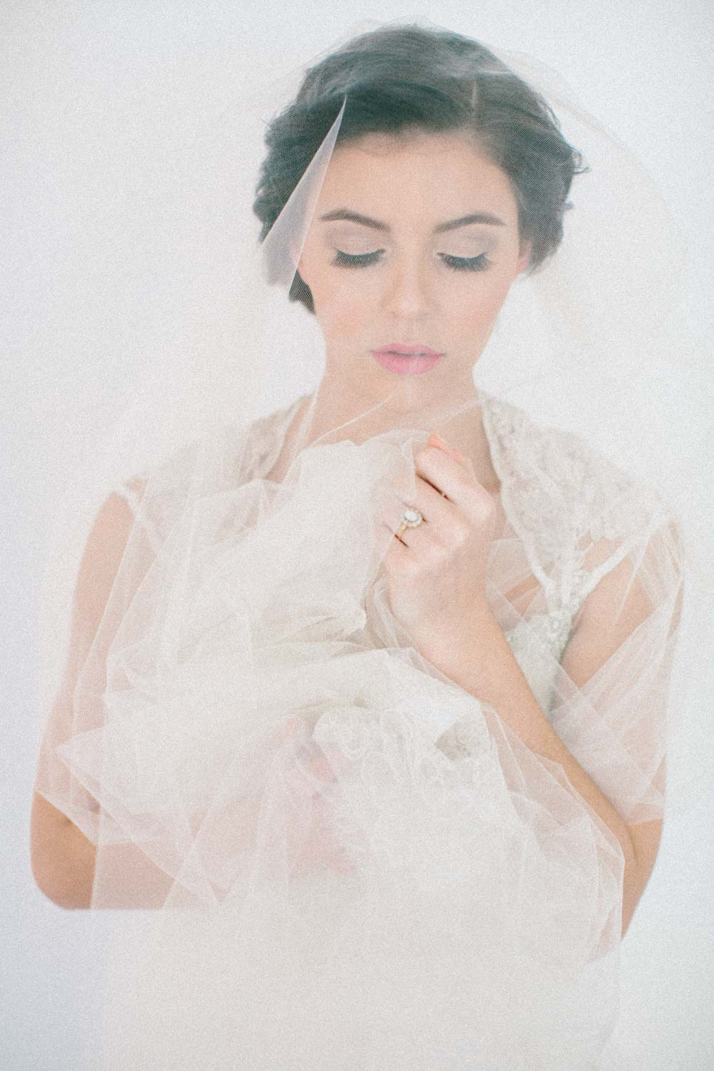 close up of bride holding sheer veil