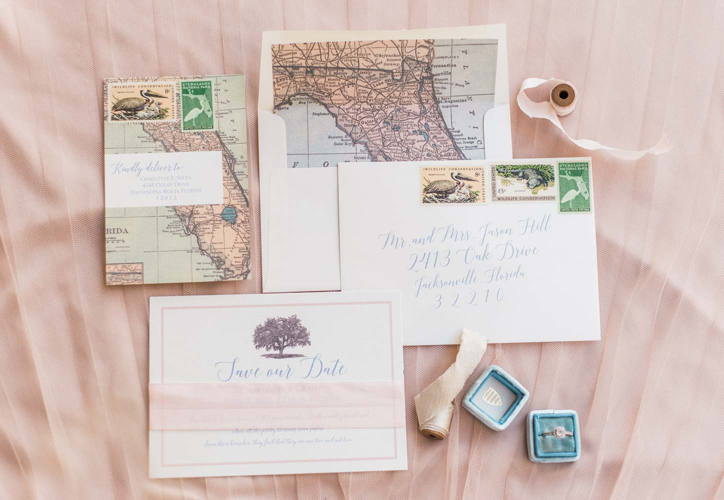 peach and white wedding stationary with map details