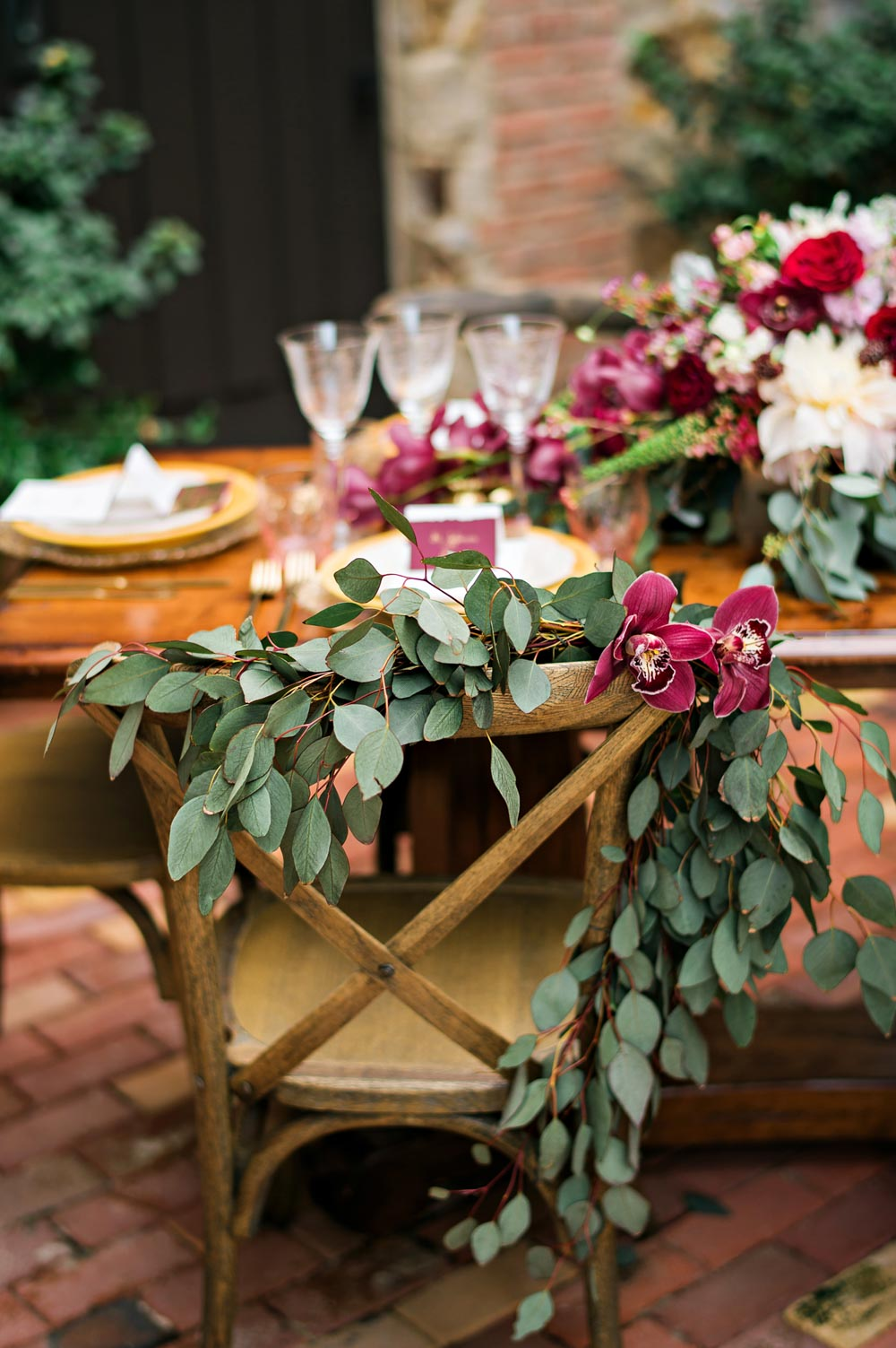 wedding table red flower centerpiece maroon green yellow gold